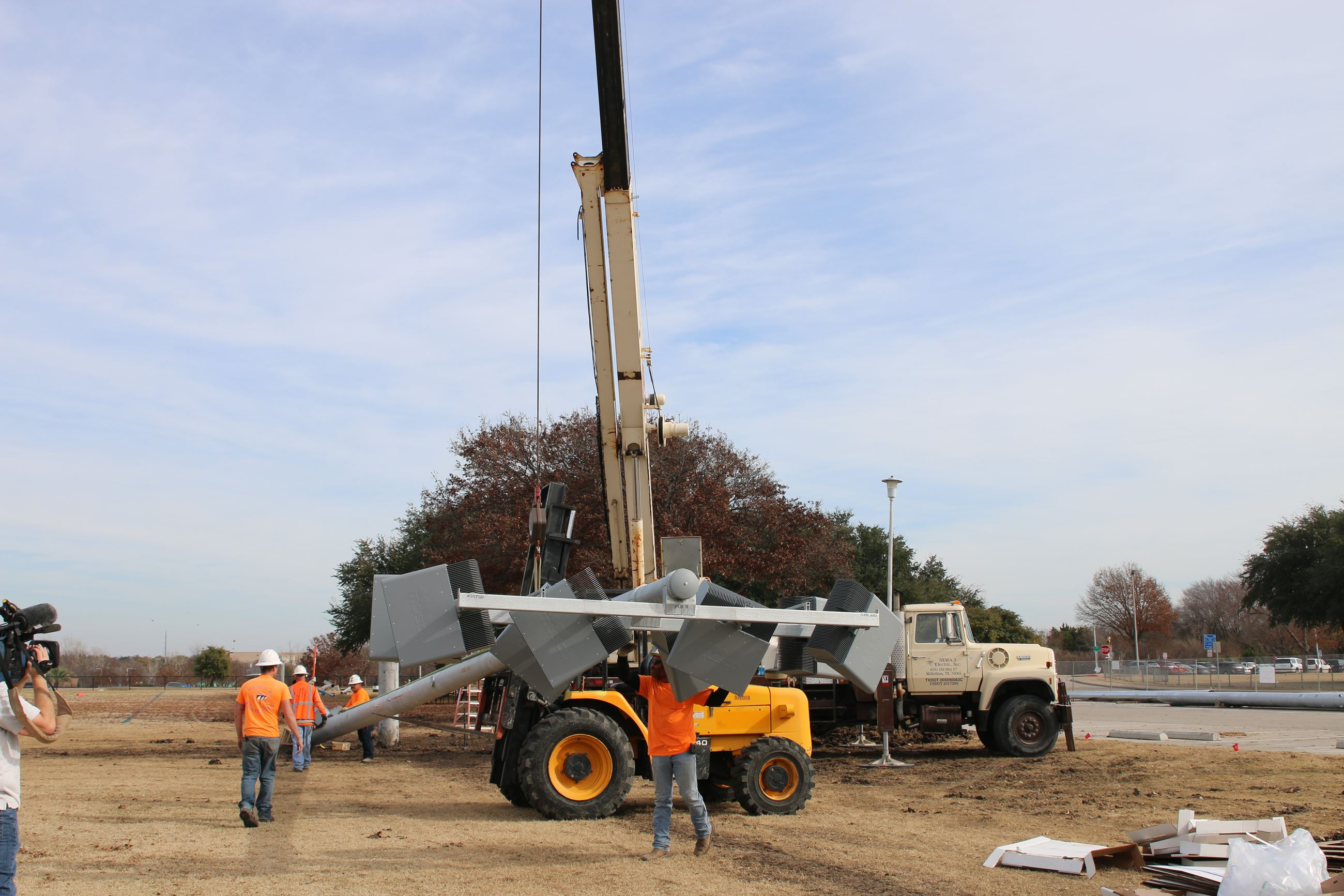 The first light pole in a $3.2 million project at Winters Park is installed on Thursday, Dec. 5.